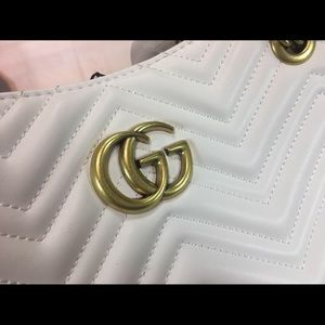 I'm selling a white authentic Gucci bag.